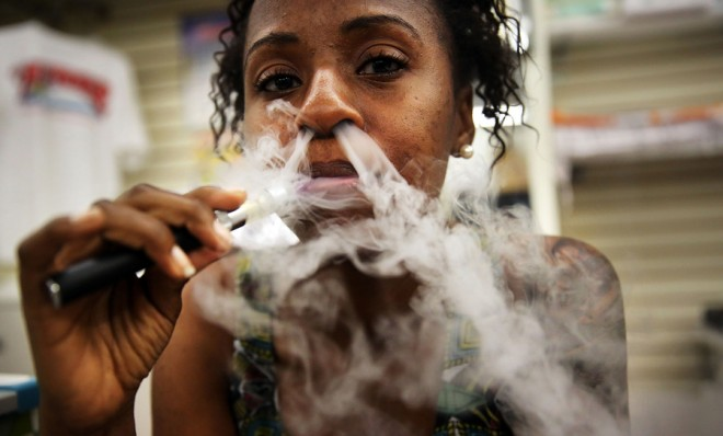 a-customer-smokes-an-electronic-cigarette-at-vape-new-york-a-dedicated-vaporized-nicotine-retailer